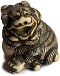 Laughing Shishi Netsuke