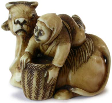 Cowherd on Ox Netsuke