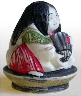 Girl on Saki Cup Netsuke